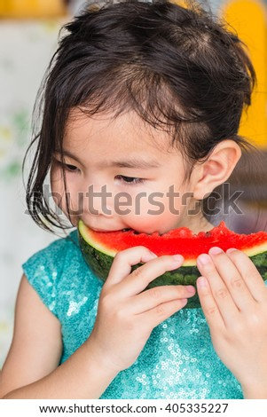 girl eating watermelon - stock photo