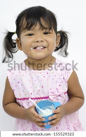 girl eating yogurt - stock photo