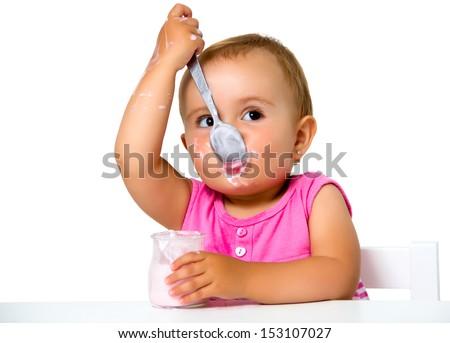girl eating yogurt isolated on white - stock photo