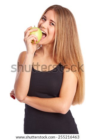 Girl eats a green apple on a white background - stock photo