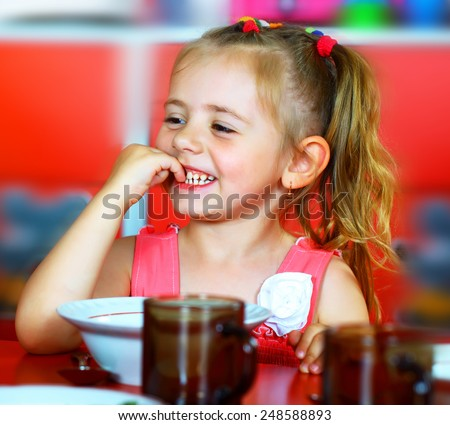 Girl eats soup plates - stock photo