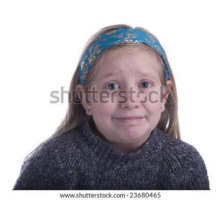 Girl embarrassed in a gray sweater on a white background - stock photo