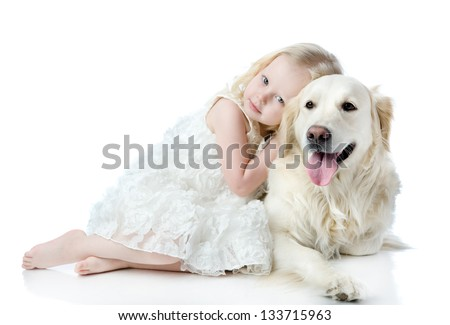 girl embraces a Golden Retriever. looking at camera. isolated on white background - stock photo