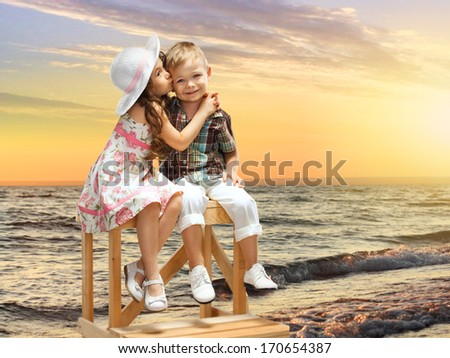girl embraces and kisses a boy - stock photo