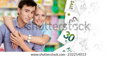 Girl embraces man after shopping. Concept of happy relationship and affection - stock photo