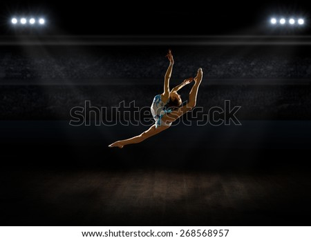 Girl engaged art gymnastic at sports hall - stock photo