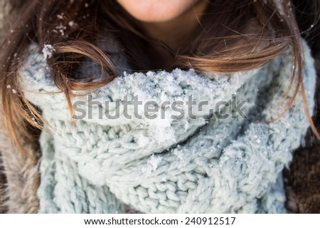 Girl enjoy snow and sunshine in winter - stock photo