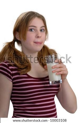 Girl enjoying a glass of milk - stock photo