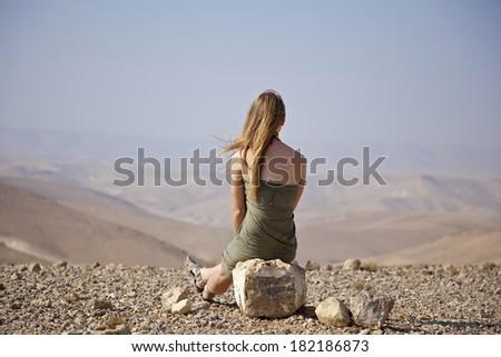 Girl enjoying the freedom in a wasteland, Negev desert, Israel - stock photo