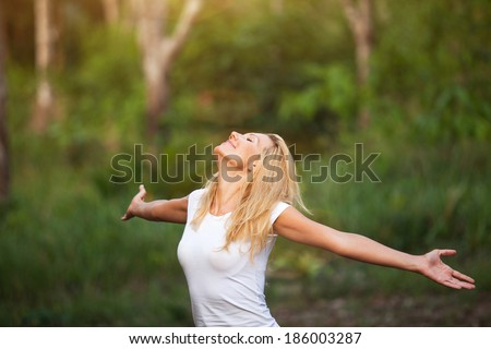 girl enjoying the sun in the nature - stock photo