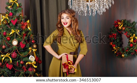 Girl enjoys gift. Christmas tree. New Year. Waiting for a miracle. Merry Christmas. 2017 - stock photo