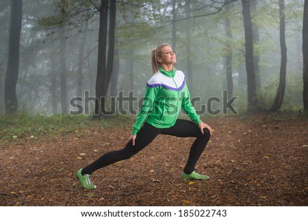 girl exercise in the morning mist - stock photo