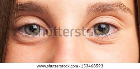 girl eyes close up on a white background - stock photo
