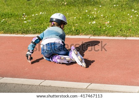 girl falling from the roller - stock photo