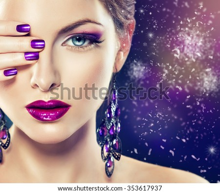 Girl fashion model with purple makeup and  lilac manicure on the nails . Long purple earrings ,  jewelry accessories . Winter snow background .   - stock photo