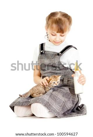 Girl feeding British kitten isolated on white - stock photo