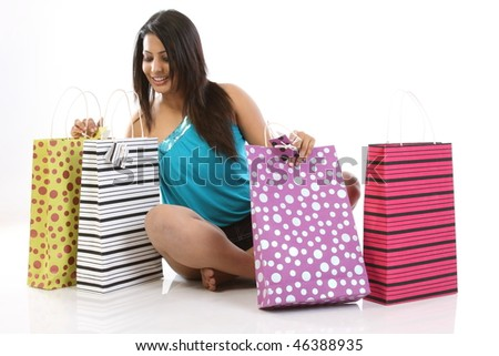 Girl feeling happy by seeing all the shopping bags - stock photo