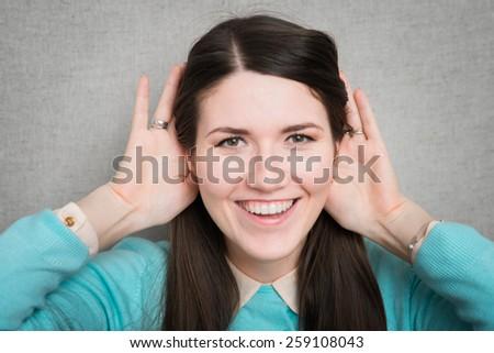 girl fooling around with big ears - stock photo