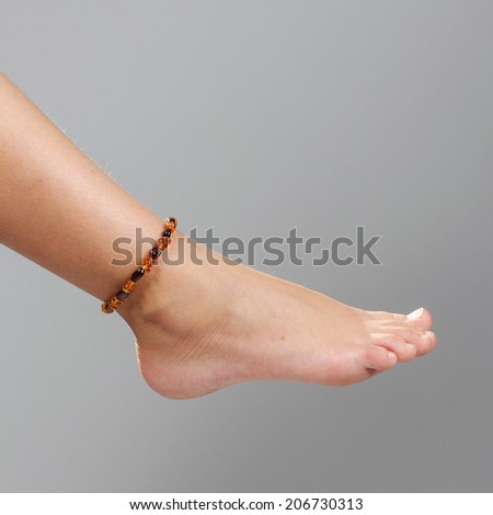 Girl foot isolated on the grey background - stock photo