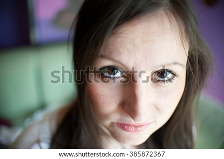 Girl frightened looking at the camera. Eyes close up - stock photo
