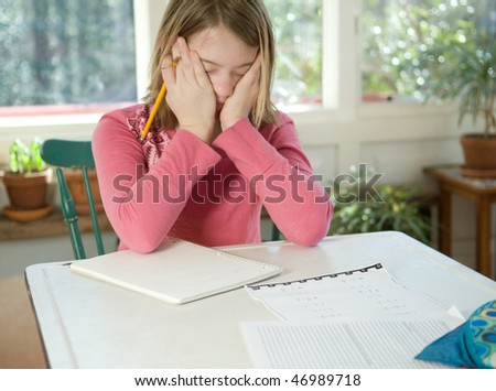 Girl frustrated with homework - stock photo