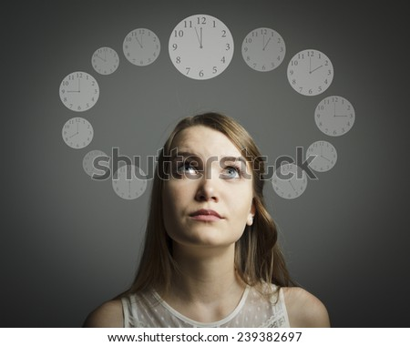 Girl full of doubts and hesitation. Time concept.   - stock photo
