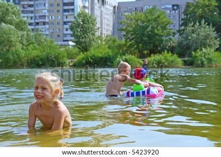 Girl gets jealous that her brothers left her. Shot in July, Dniepropetrovsk, Ukraine. - stock photo