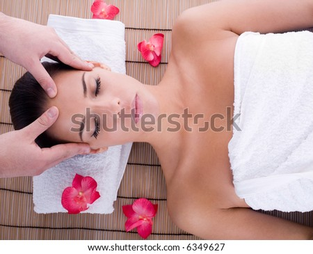 girl getting head massage - stock photo