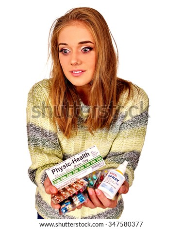 Girl giving medicine. The reasons may be different. Colds, allergies or depression. Isolated. - stock photo