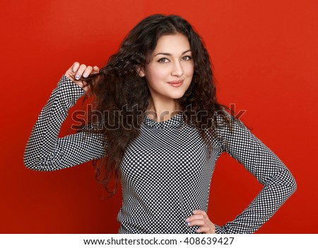 girl glamour portrait on red background, long curly hair - stock photo