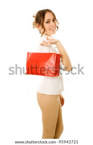 Girl going home carrying shopping bags on her shoulder with happy expression - stock photo