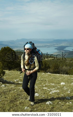 Girl going up along the hill - stock photo
