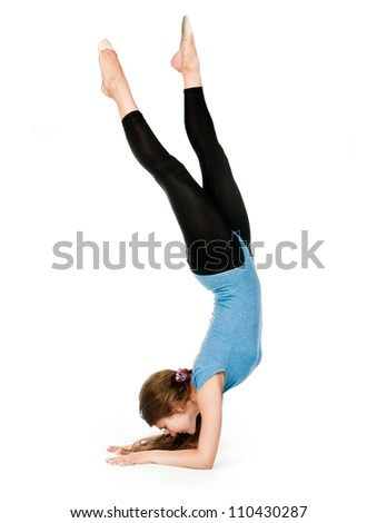 girl gymnast in blue sport suit  on a white background - stock photo