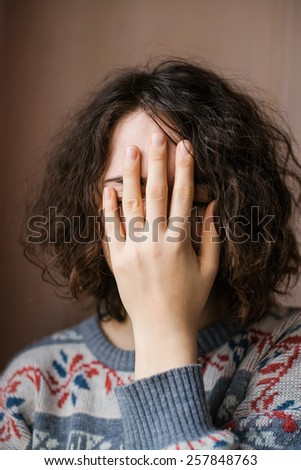 girl hand obscures the face - stock photo