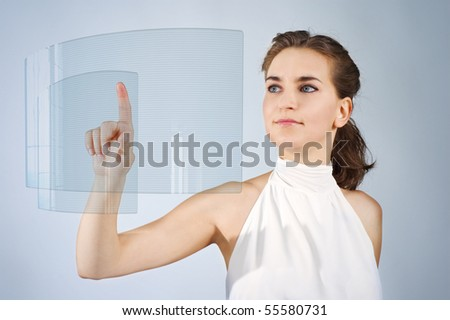 girl happy attractive touch screen over blue background - stock photo