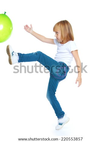 Girl has a foot balloon isolated on white background.The concept of development of the child, the child's upbringing. - stock photo