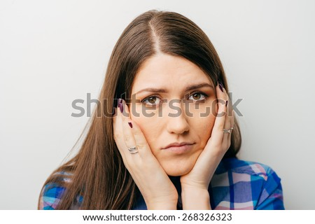 girl has a toothache and she keeps a hands on her cheek - stock photo