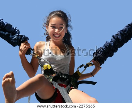 Girl having a good time bungee jumping - stock photo