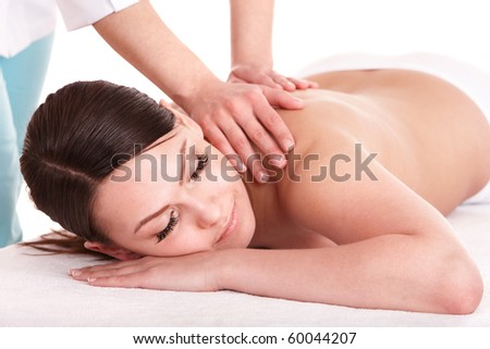 Girl having back massage. Isolated. - stock photo