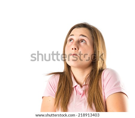 Girl having doubts over isolated white background - stock photo