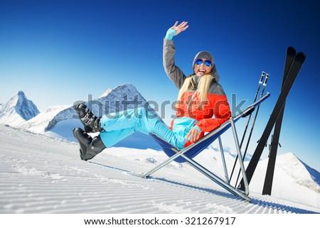 Girl having fun in ski resort - stock photo