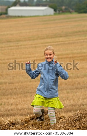 Girl having fun in the field - stock photo