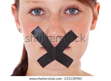Girl having her mouth taped.  - stock photo