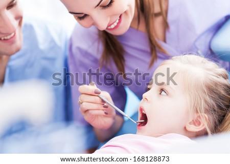 Girl having teeth examined at dentists - stock photo