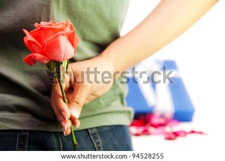 Girl hiding back red rose flower - stock photo