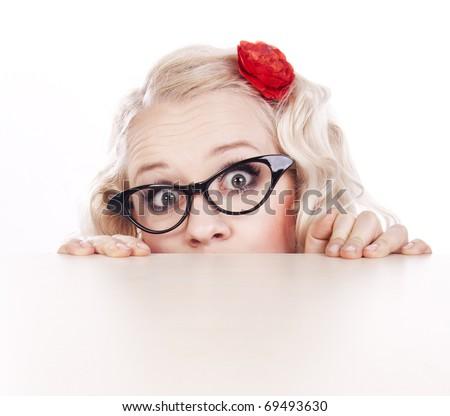 Girl hiding behind a desk - stock photo