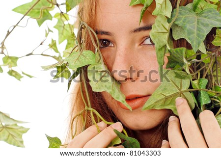 Girl Hiding Behind Ivy Vines - stock photo