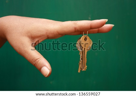 Girl holding a bunch of keys - stock photo