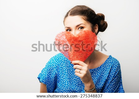 girl holding a paper heart - stock photo