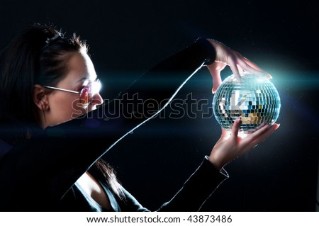 Girl holding a shining sphere - stock photo